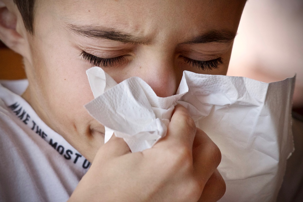 child sneezing because he is sick